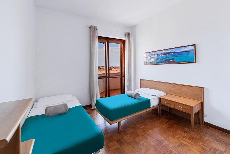 110-la-maddalena-affitto-immobiliare-residenza-sabatini-camera
