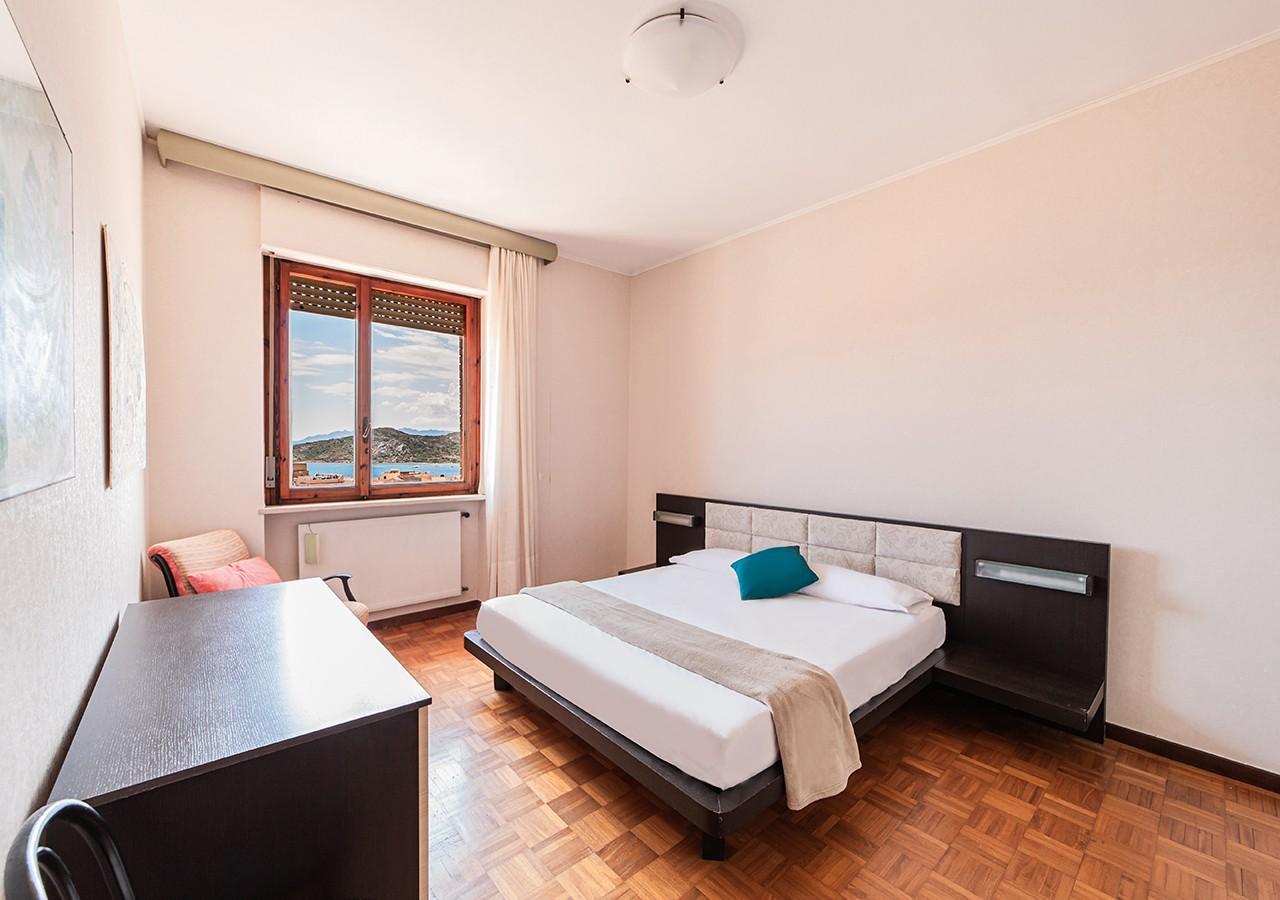 130-la-maddalena-affitto-immobiliare-residenza-sabatini-camera